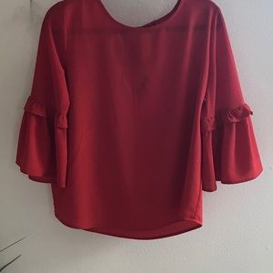 Red blouse.  Ties in the back